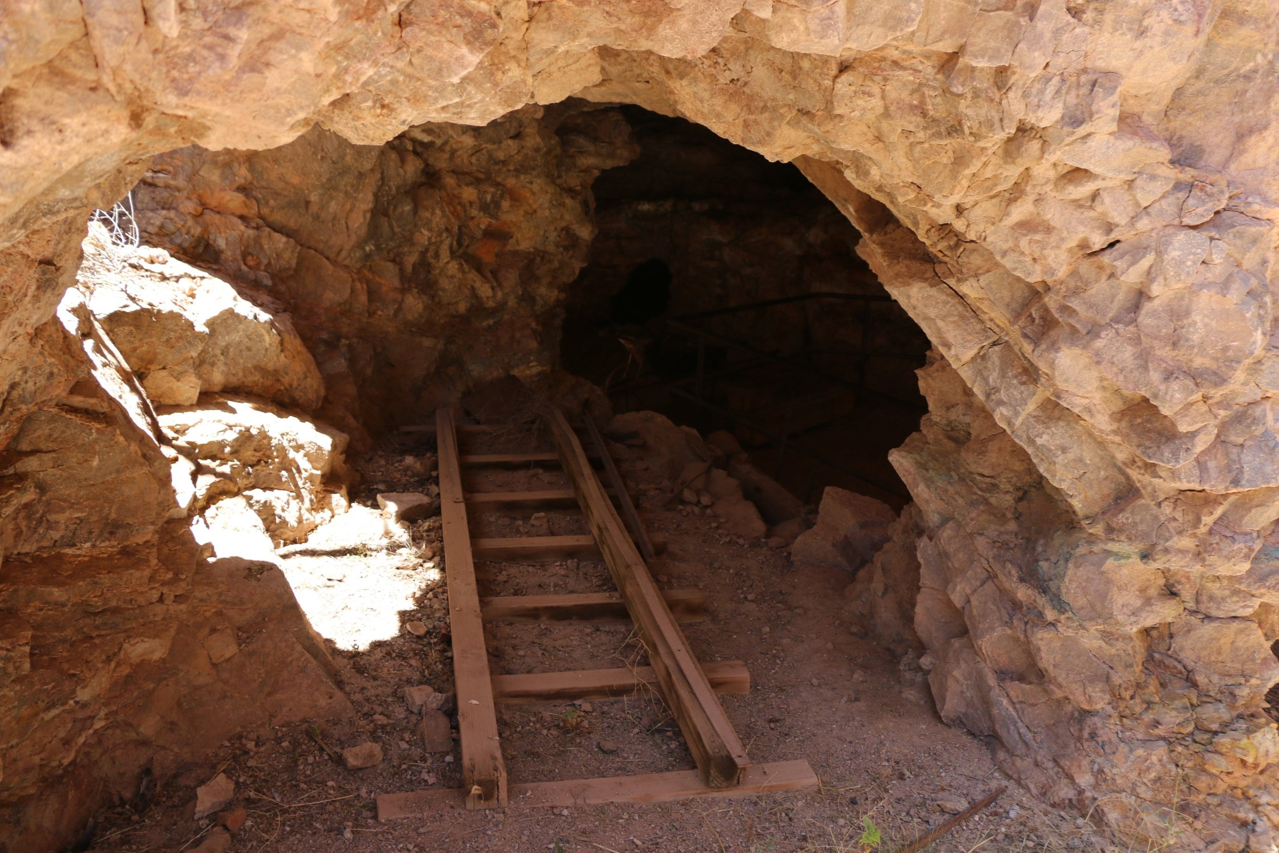An old ladder sits near the entrance of the Good Enough silver mine.