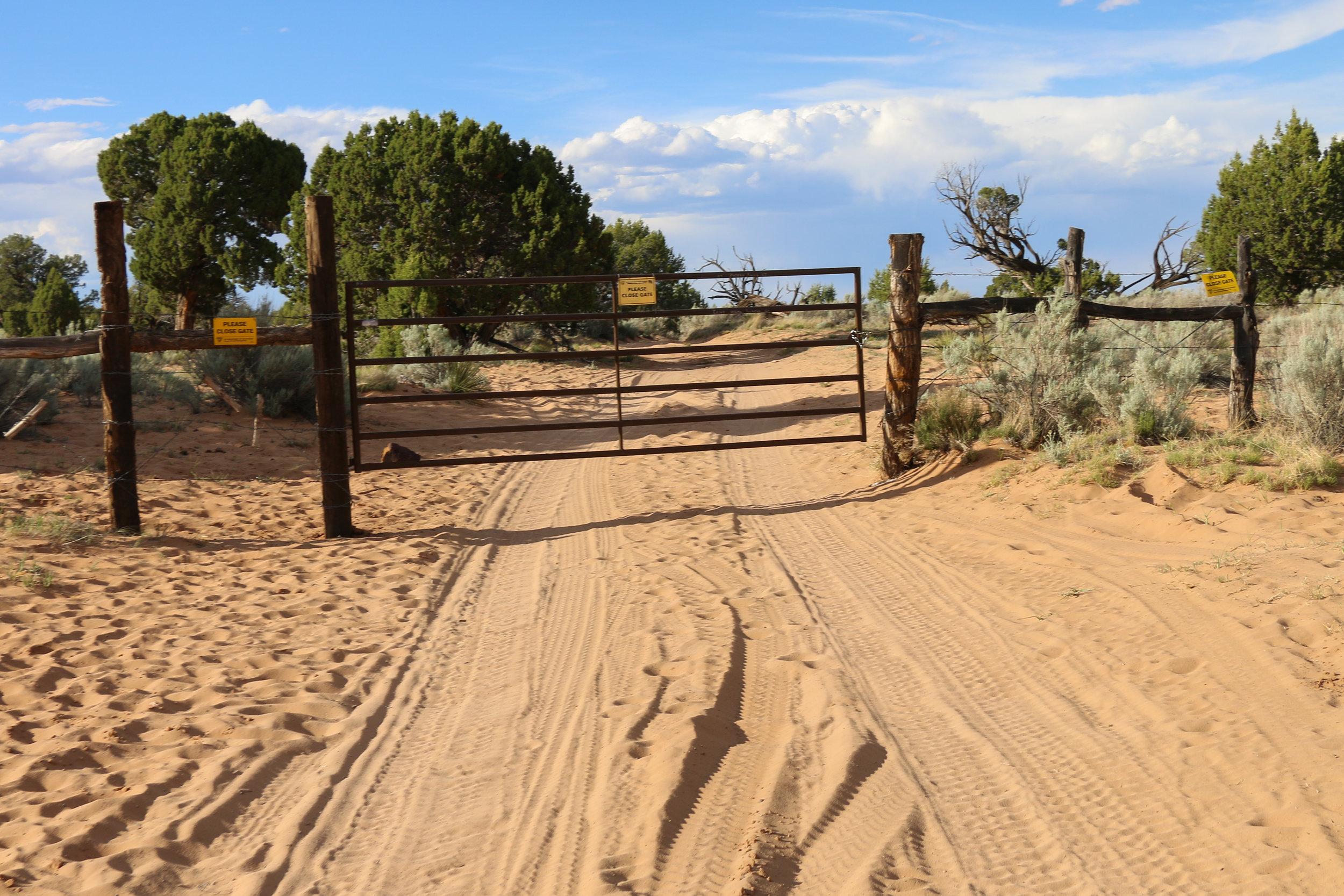 Gate along the sandy trail to White Pocket.