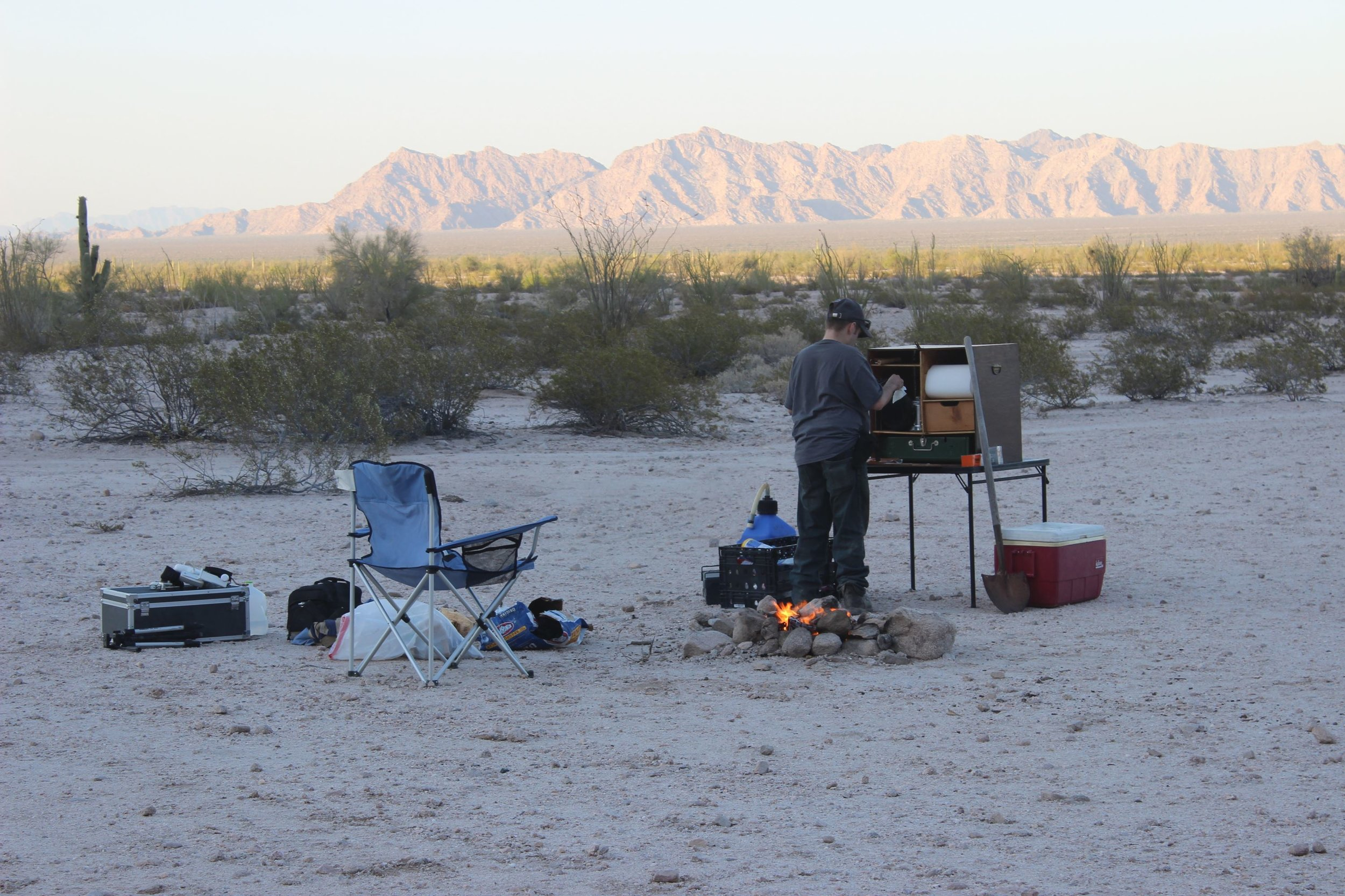 Prepping dinner with the Cabeza Prieta Mountains in the background.