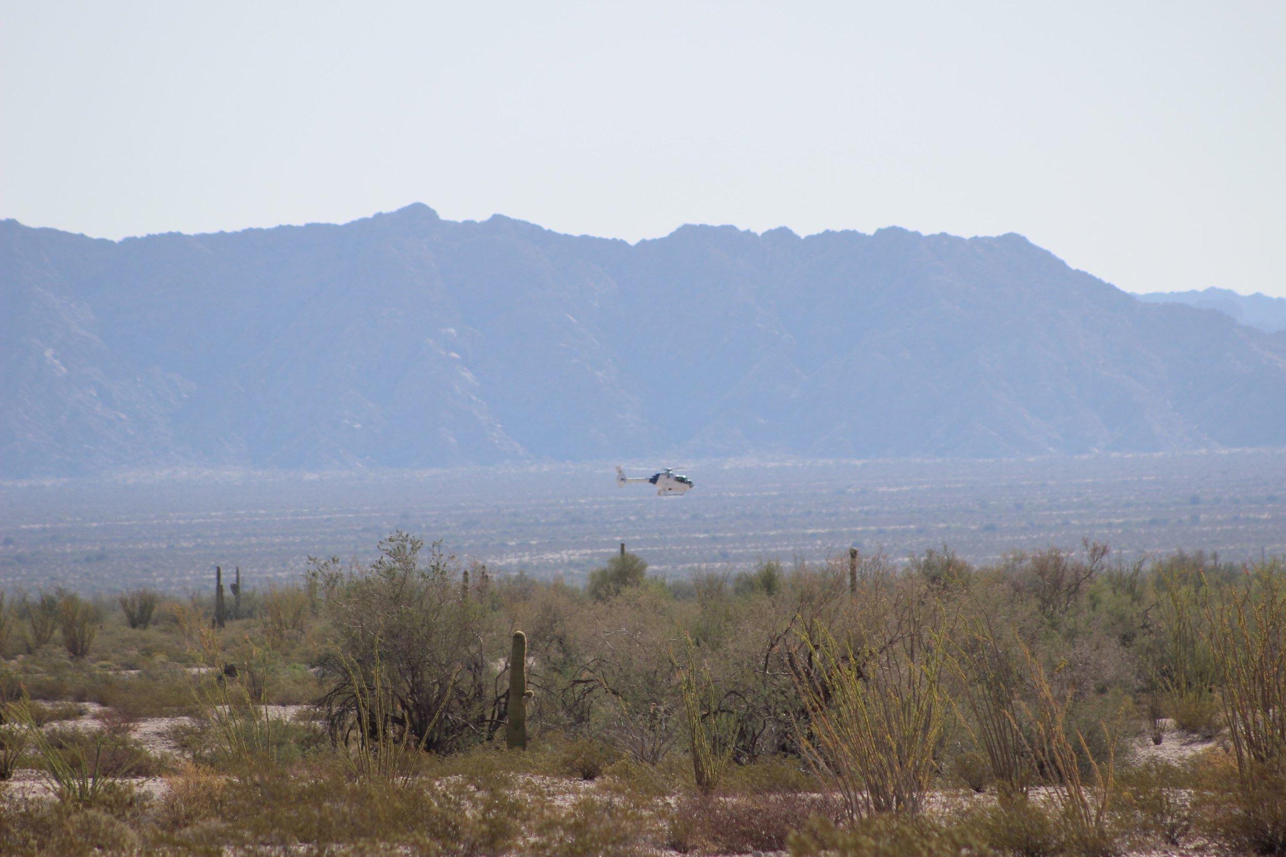Border Patrol helicopter flying low over El Camino Del Diablo.