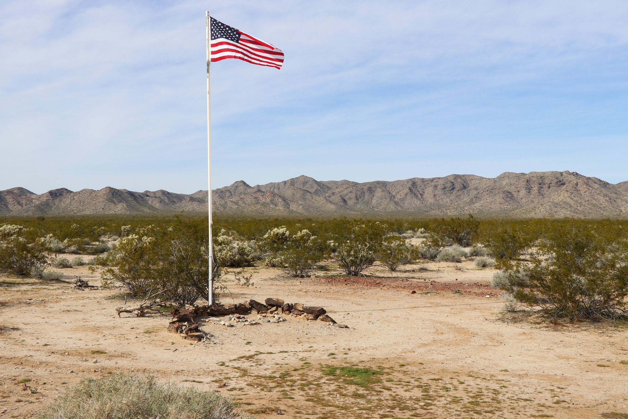 The flag remains above Camp Bouse.