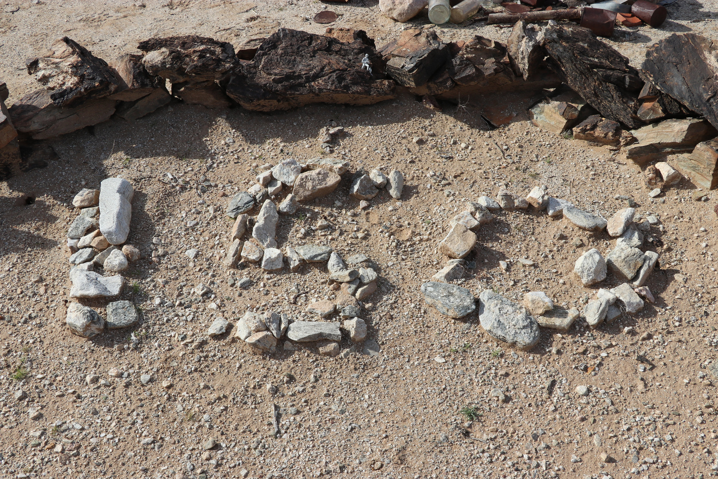 Rock outlines dedicated to those who served at Camp Bouse.