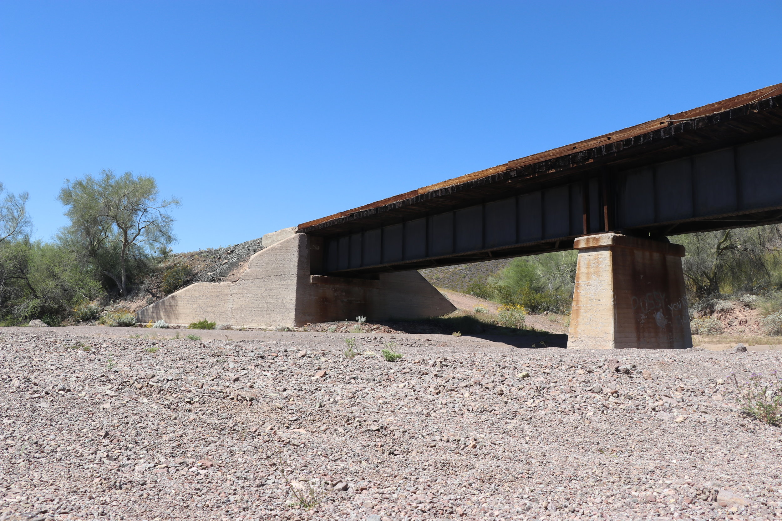 The concrete embankment (left) was damaged from the derailment.