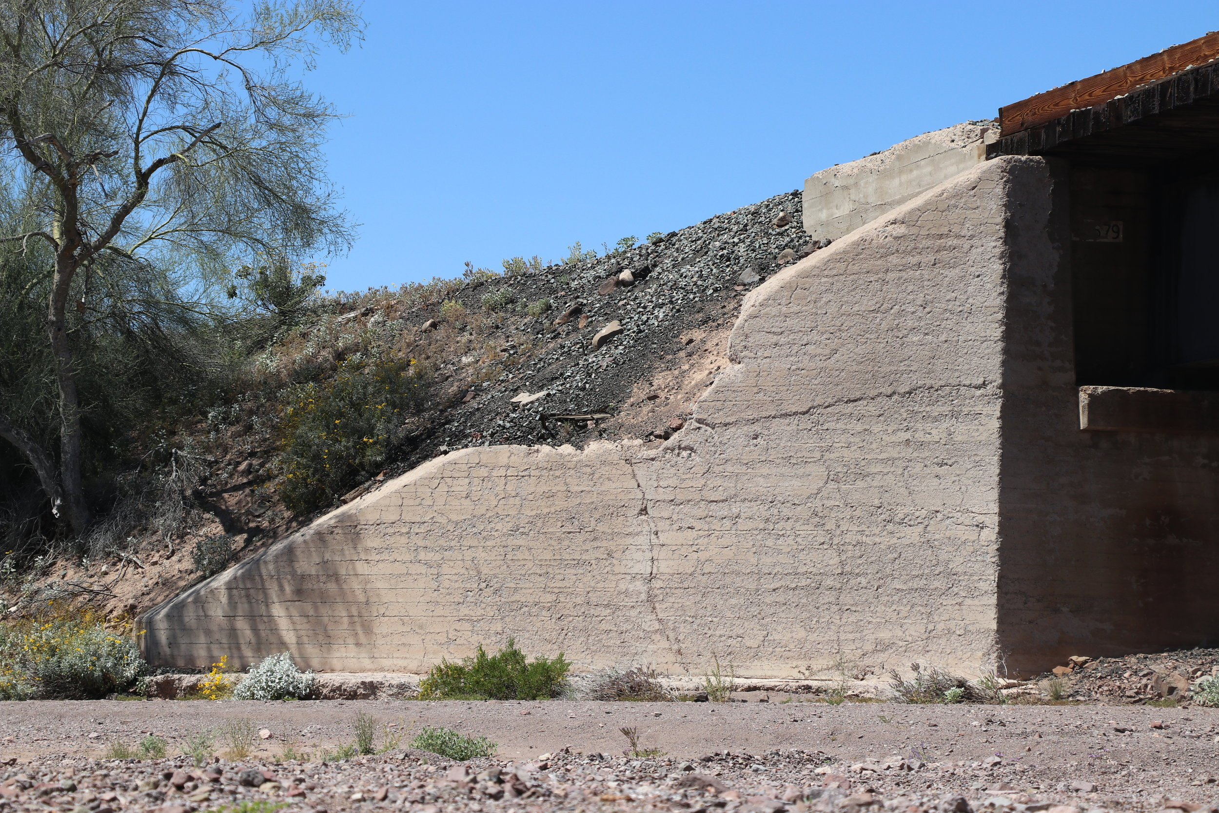 The damaged embankment on the west side of the wash.