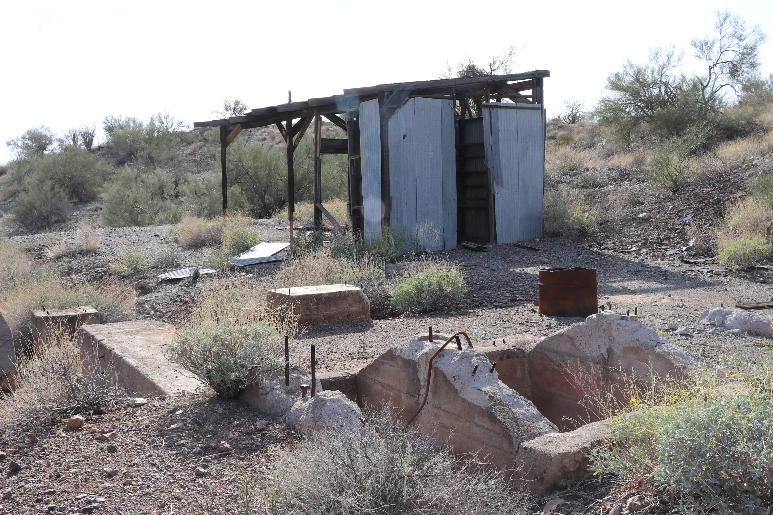 Cement foundations and an old shed remain near the mouth of the mine.