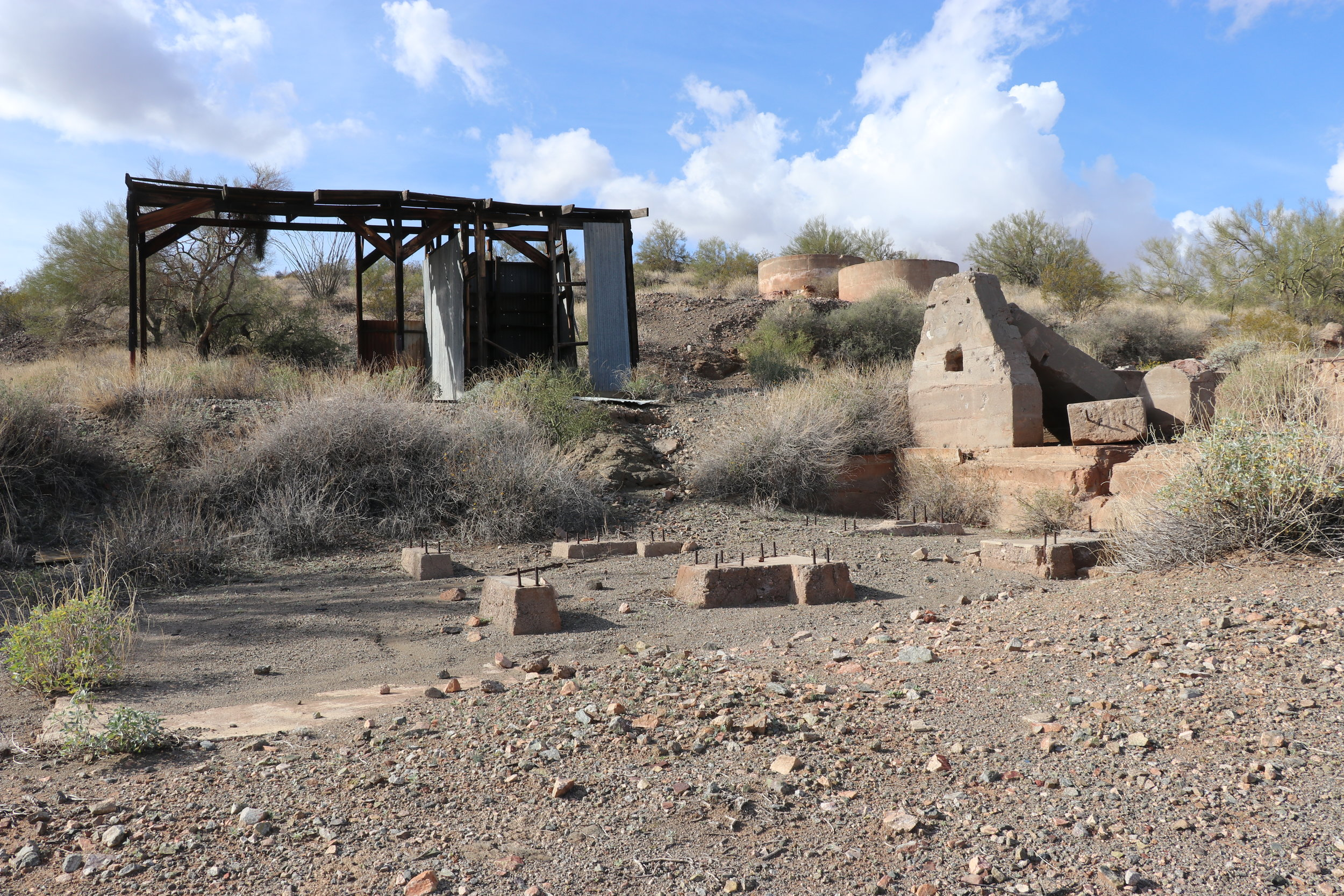 Stamp mill ruins and a tool shed remain near mine adits.