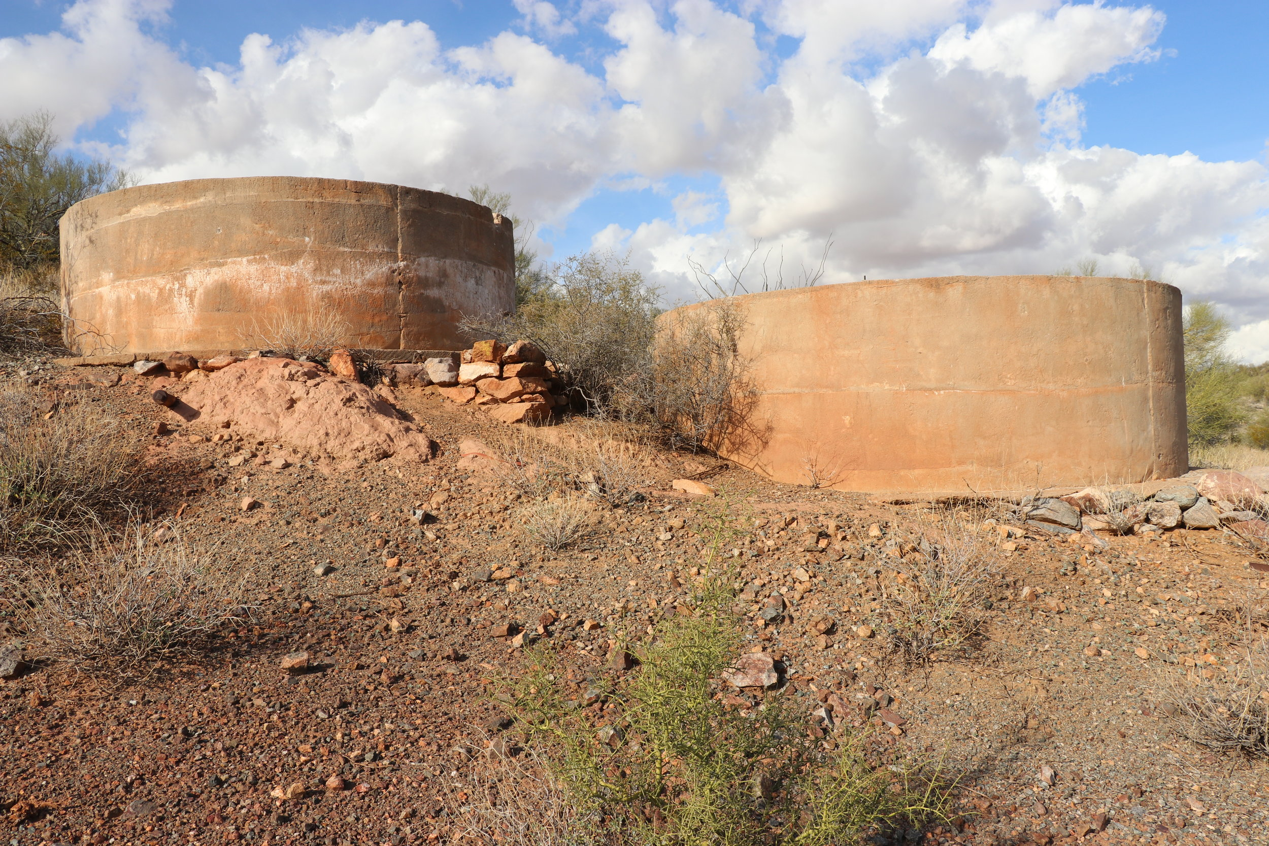 Several water tanks remain perched above the mill site.