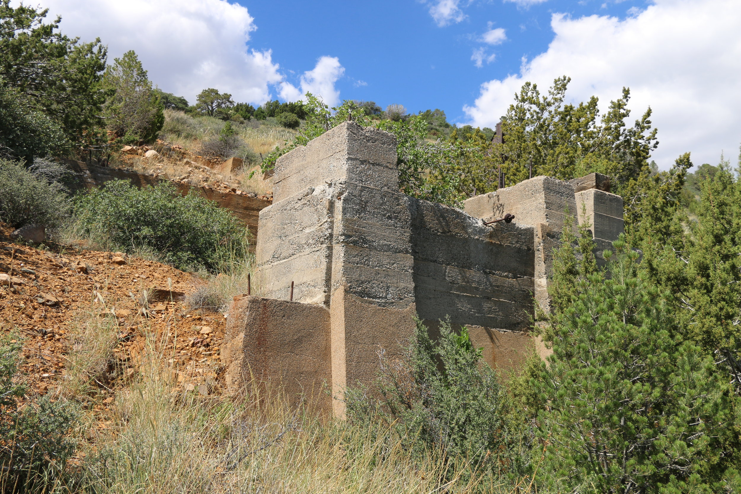 Cement foundations remain on hillside.