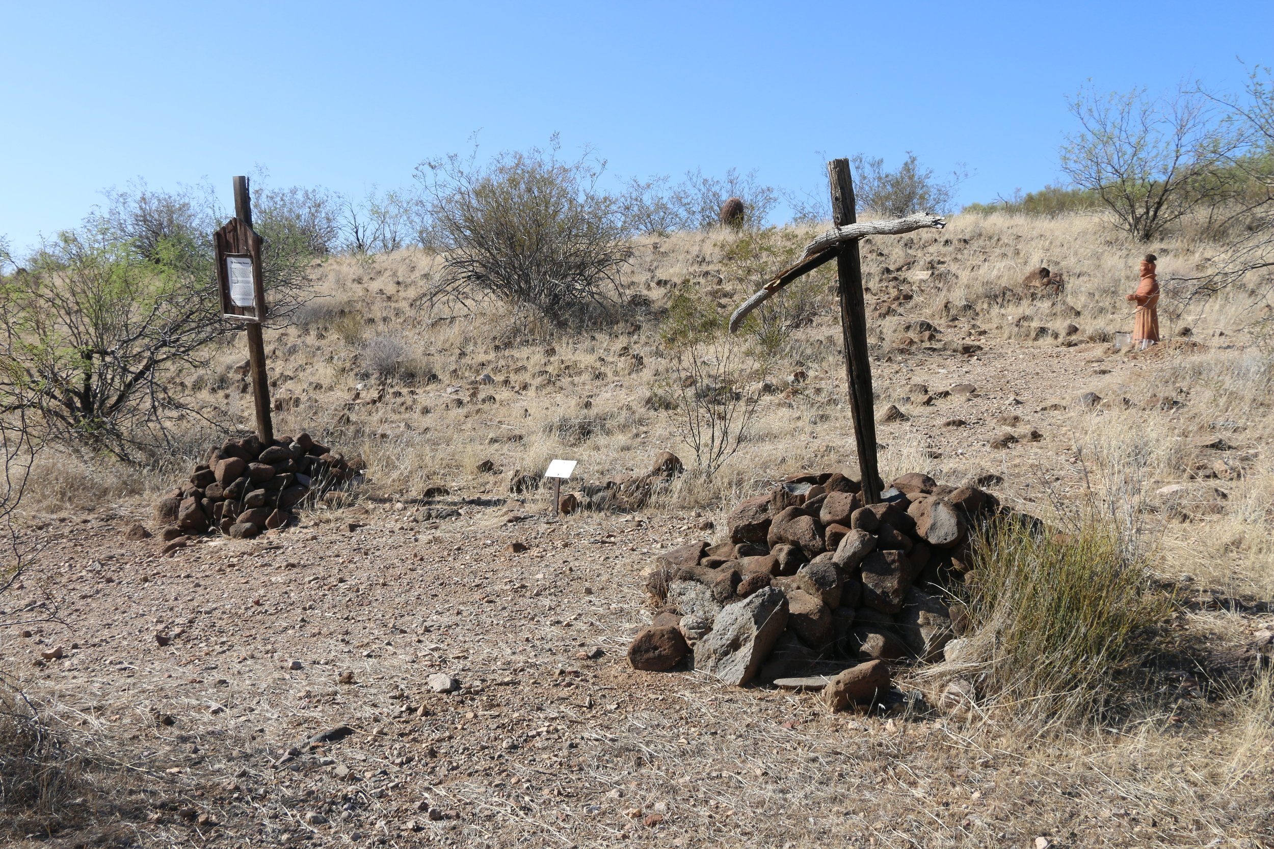 Gravesite markers remain at the massacre site today.