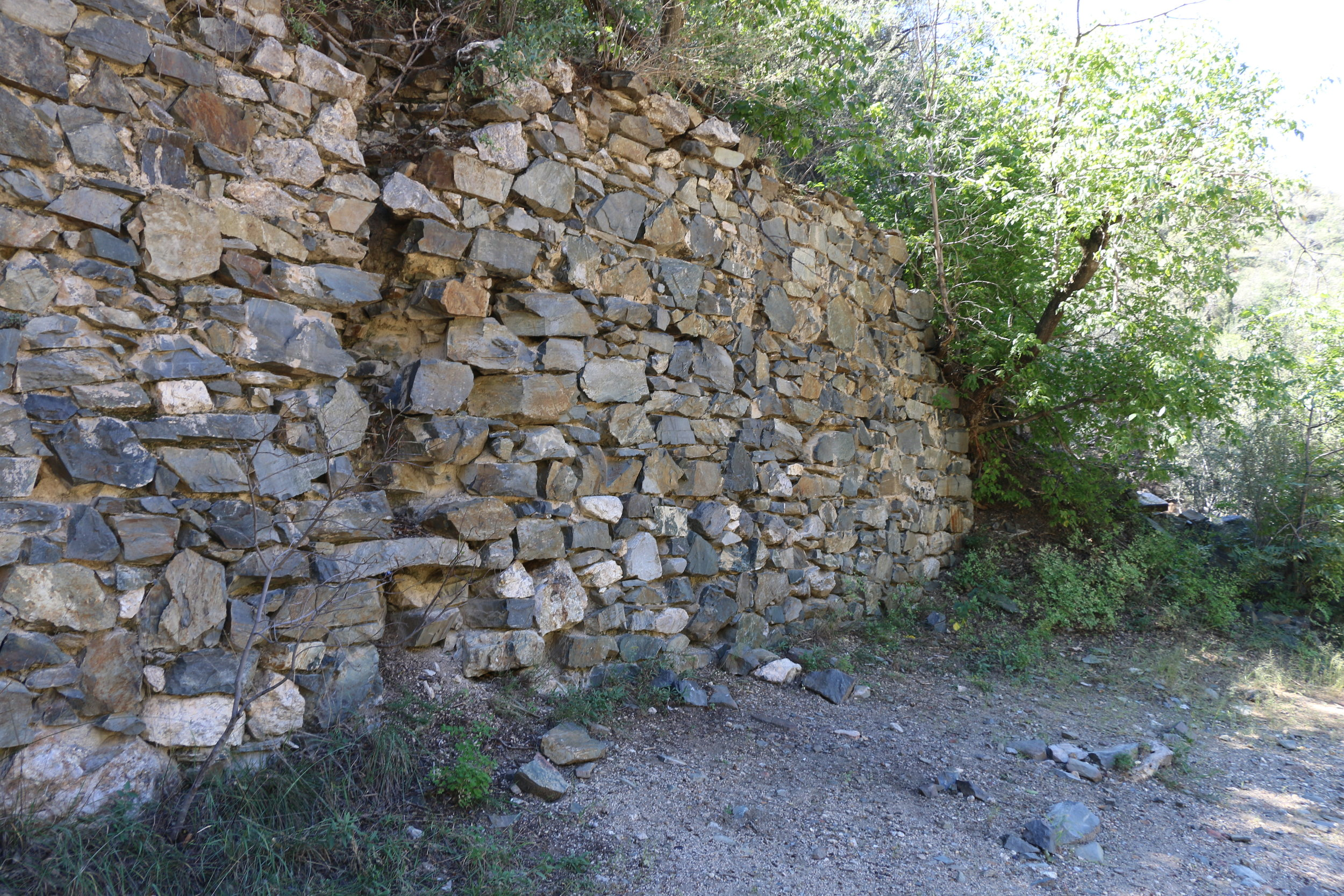 Only one wall remains of the boarding house. This is the most visible ruin from the road.