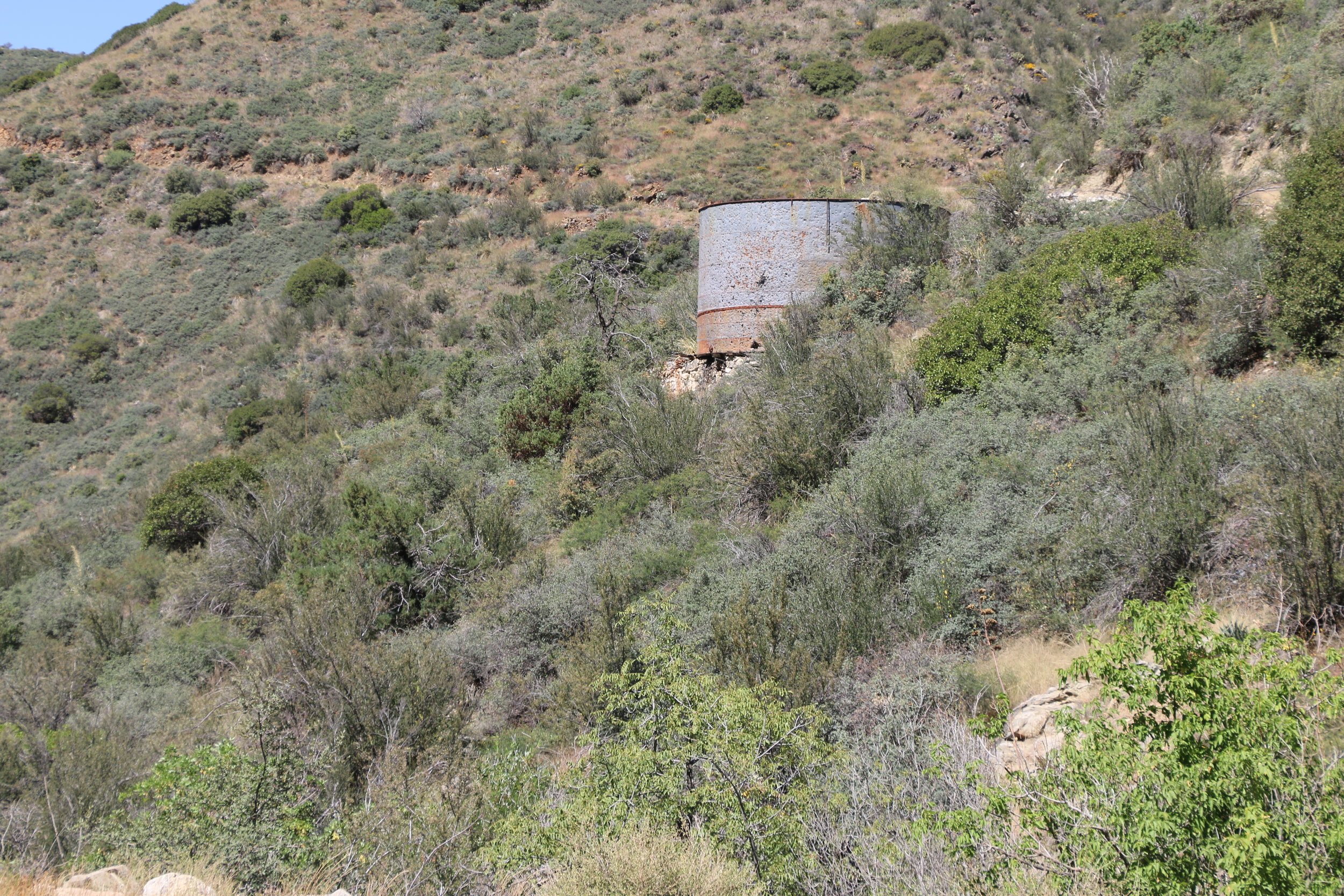 A water tank remains by the trail as it climbs towards Crown King.