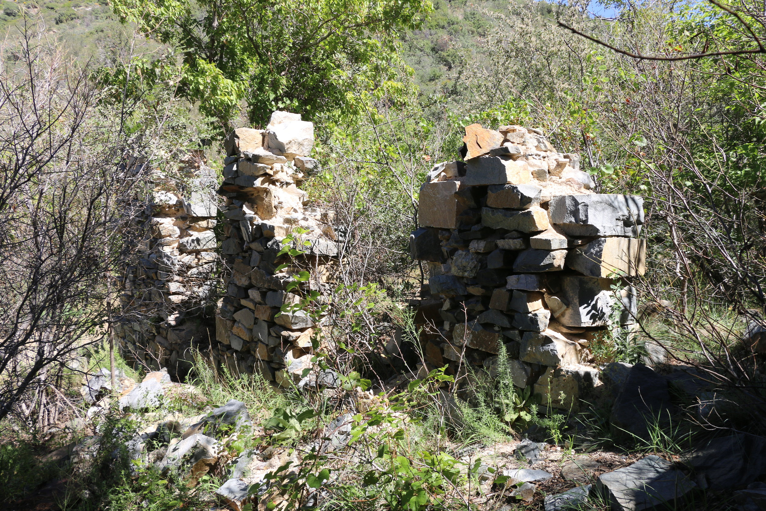 The stone wall of a ruin left at Oro Belle.