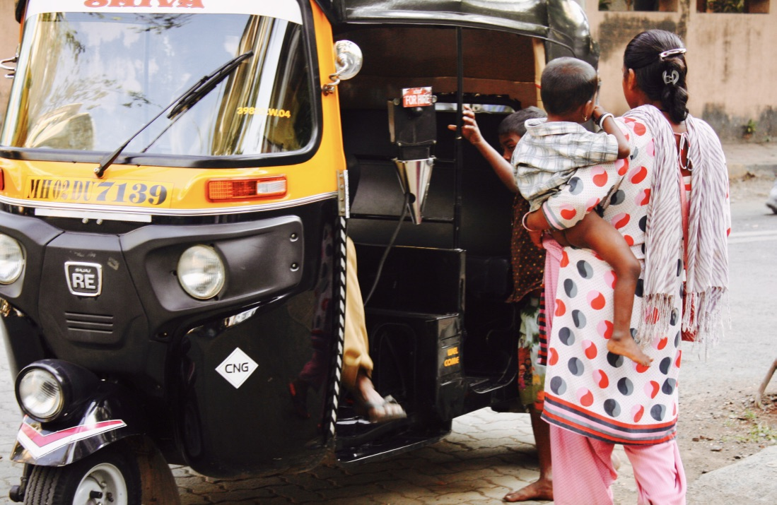 Mumbai rickshaw woman with baby