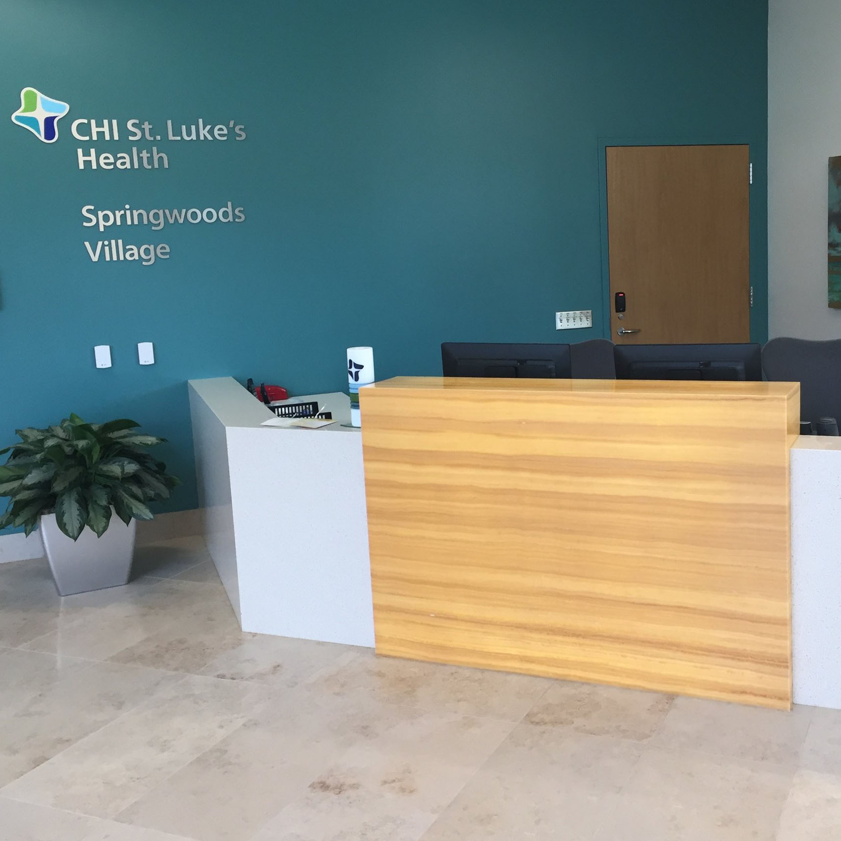 St Lukes Reception Desk - A reception desk that performs well, lasts in high traffic, and defines the space