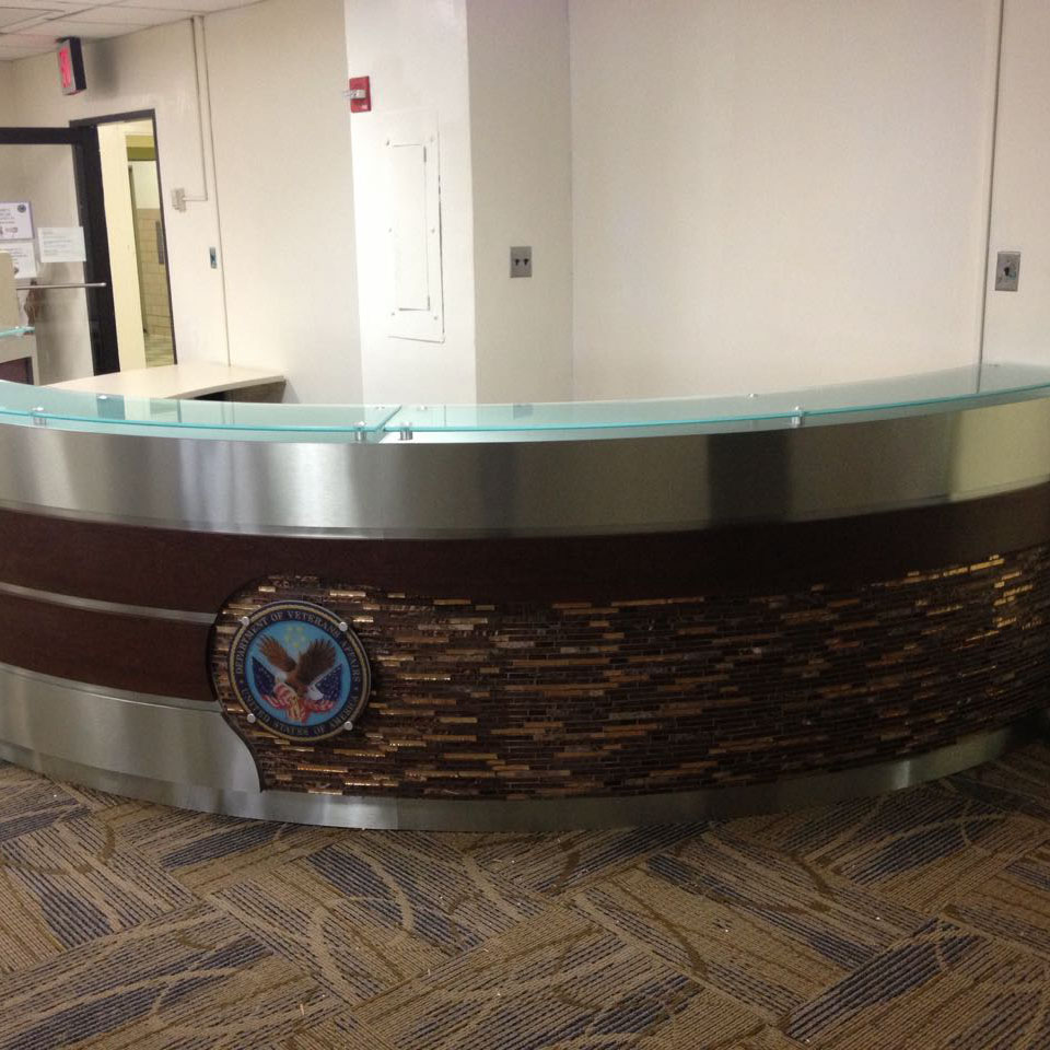 VA Reception Desk - A unique combination of finishes for a modern reception area