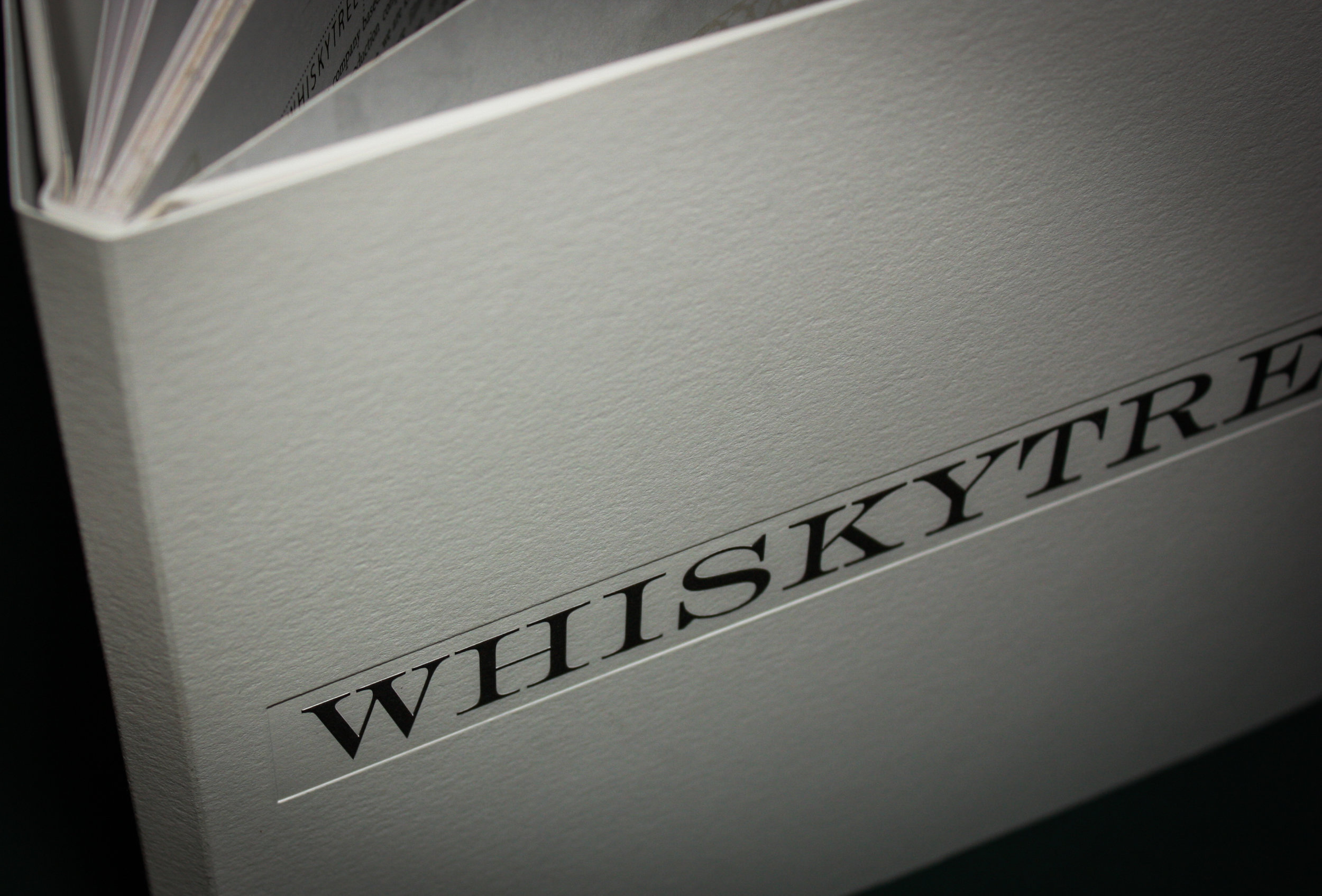 Whiskytree Dust Jacket Client:  Whiskytree  Dust jacket made with 100-pound Cranes Letra, black offset print, and registered deboss.