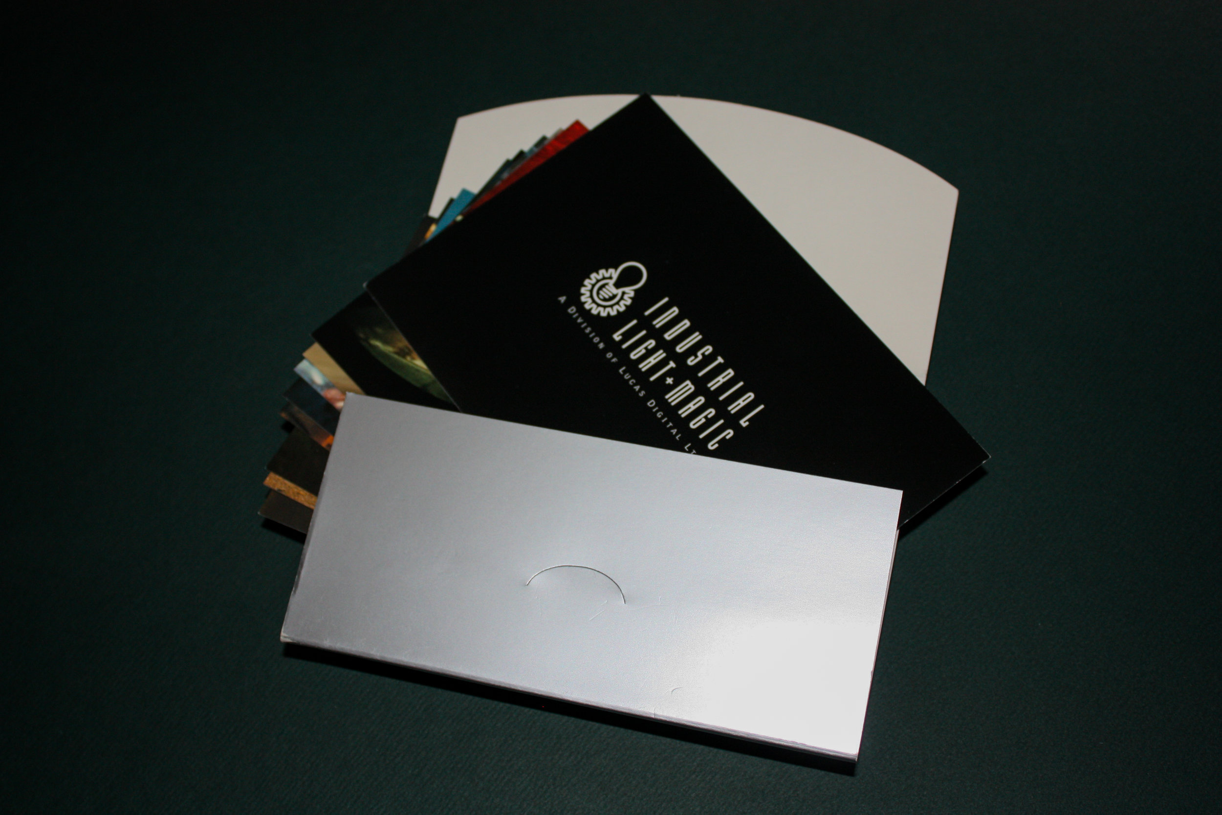 Promotional Sleeve with Postcards Client:  ILM  Outer sleeve diecut & embossed, multiple post cards inserted, then sealed with locking tab.