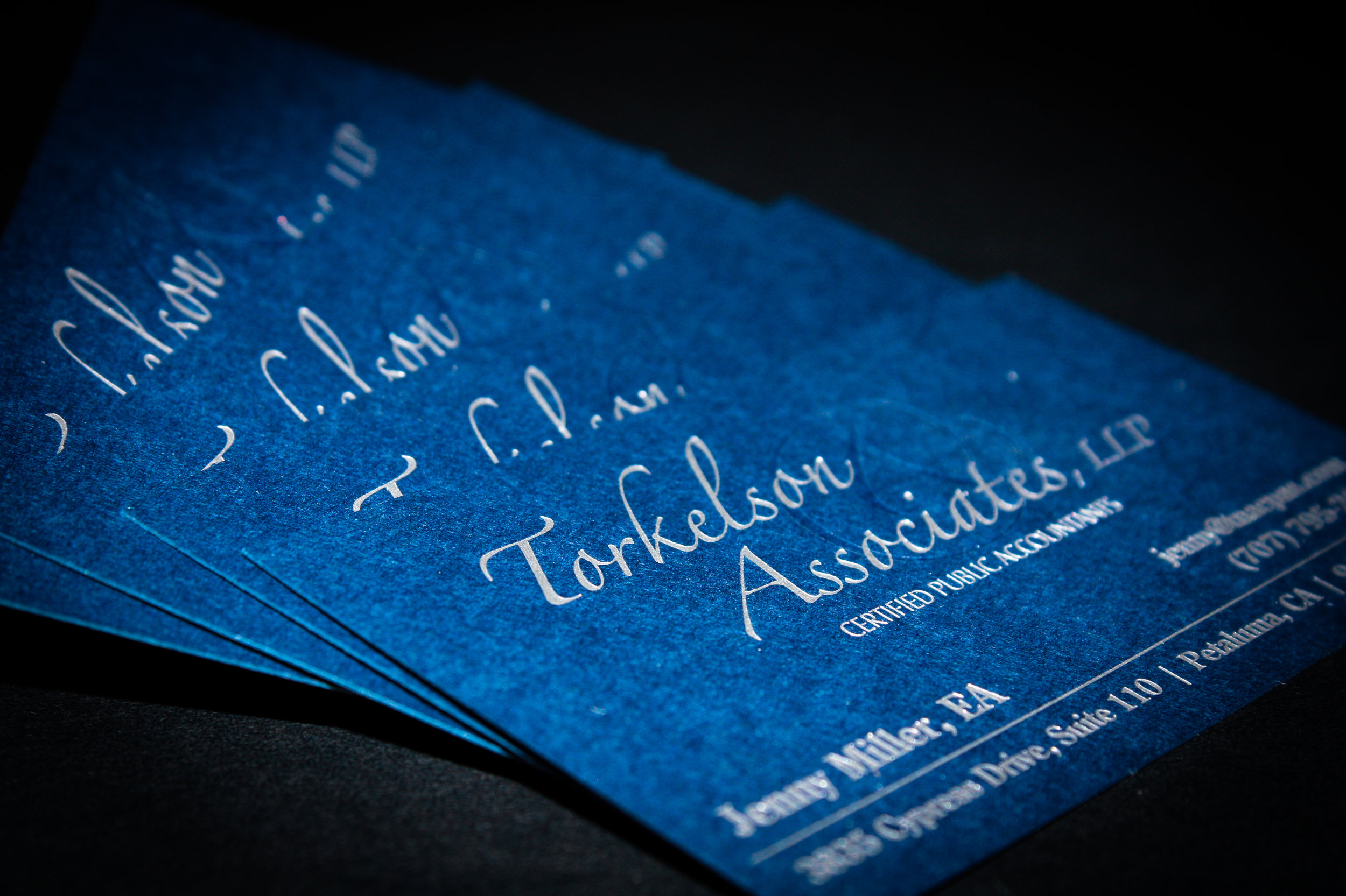 Torkelson & Associates   Created complete foil/embossed business system.