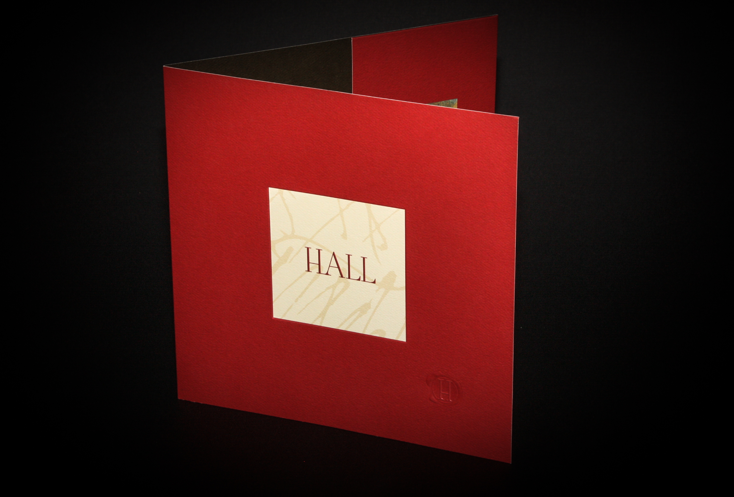 HALL Wines Client:  Odell Printing  Combination of clear foil and embossing of logo on outer front cover.
