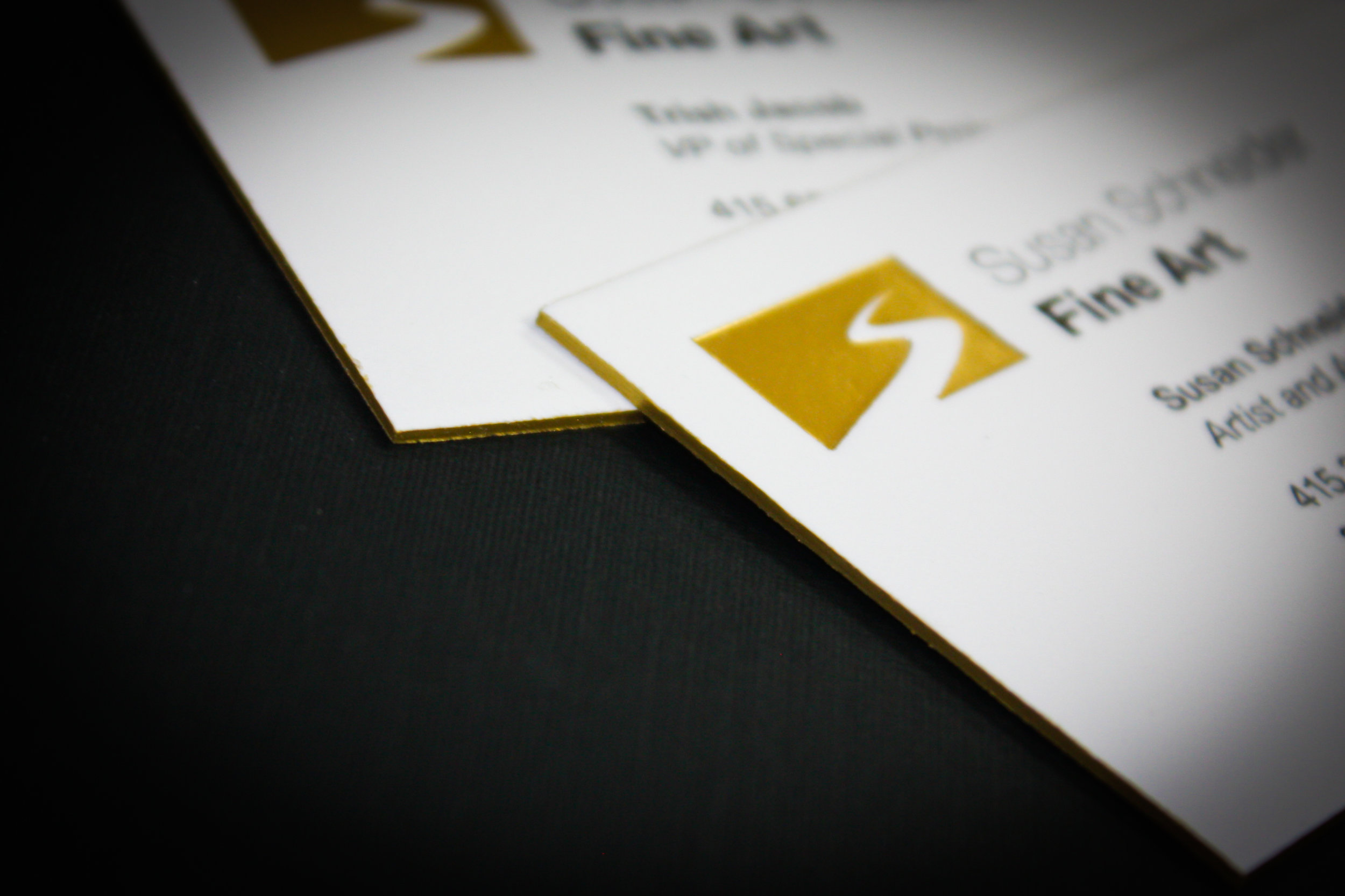 Business Cards Client:  Susan Schneider Fine Art  Gold foil and letterpress printed business cards with custom gold painted edges.