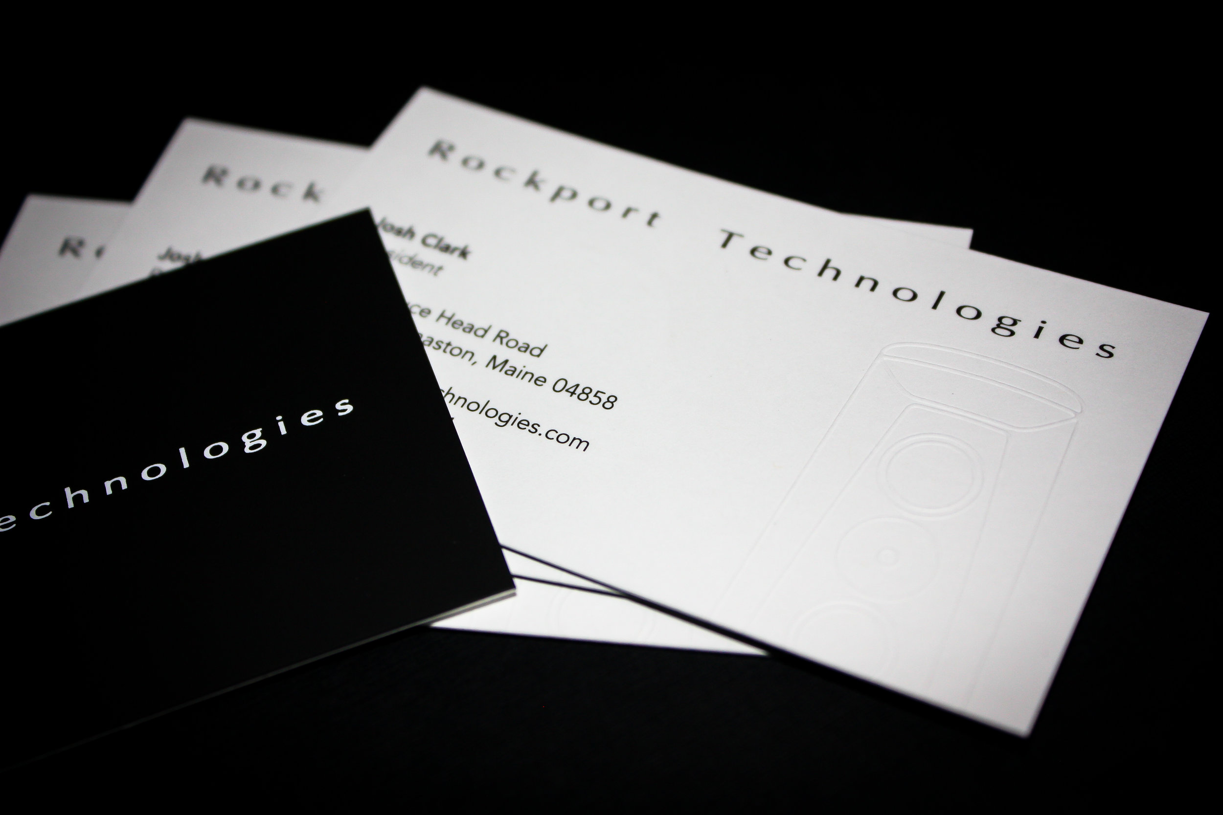 Business Cards Client:  Rockport Technologies  Black printed and blind embossed business cards mounted on black stock with white foil.