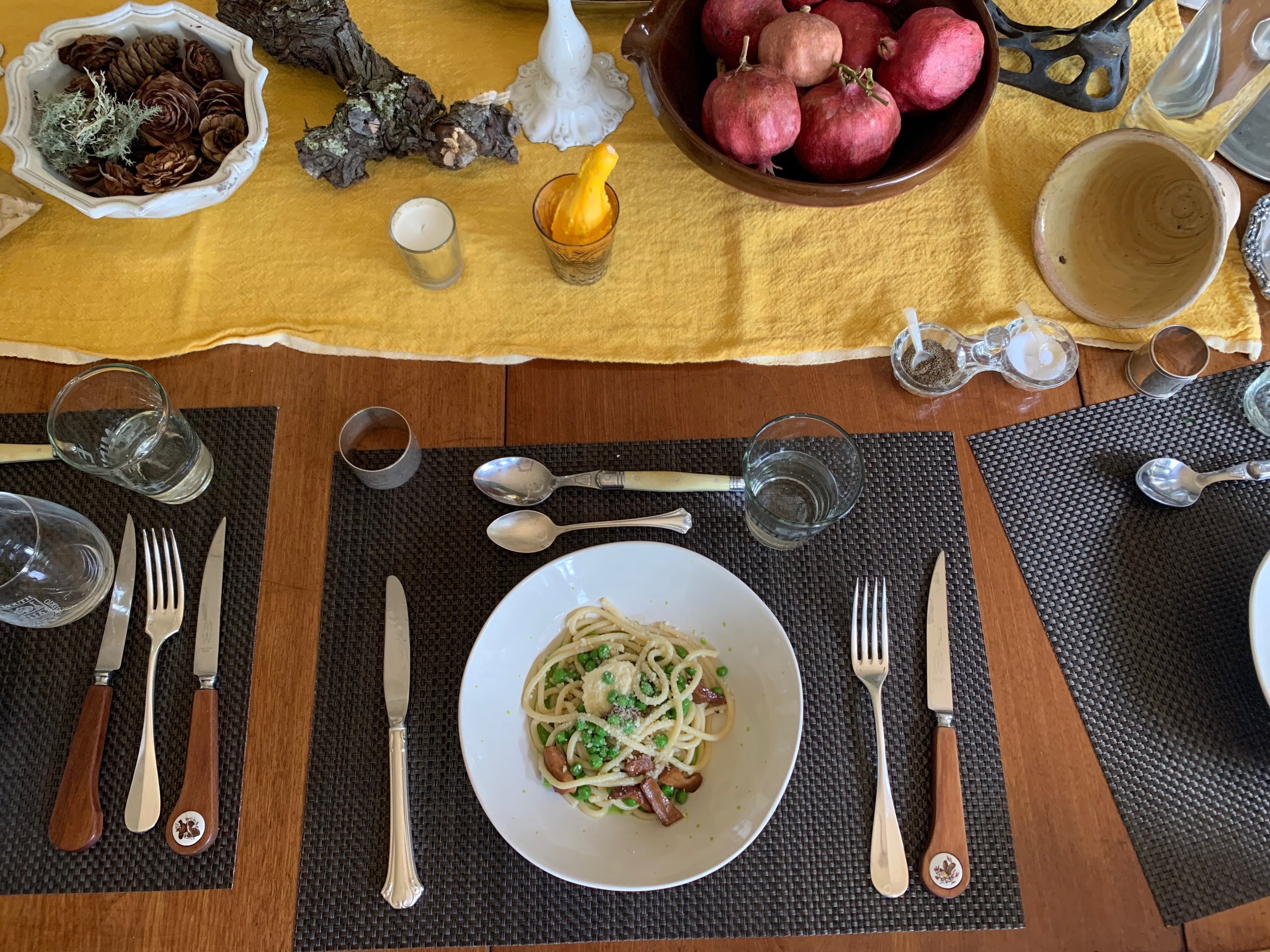 Fall tablescape with fresh pici pasta, English pea sauce, foraged chanterelles, ricotta and a little pecorino.