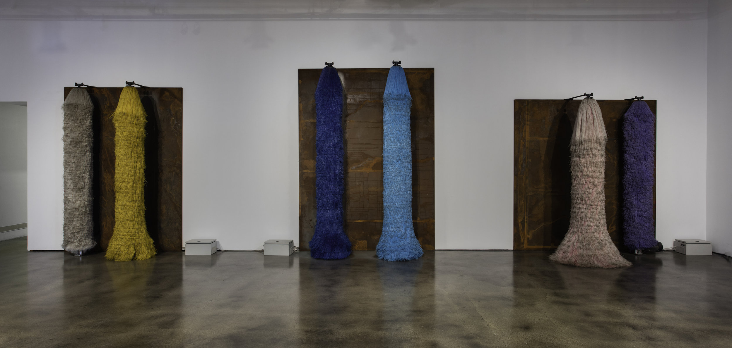 Lara Favaretto,  Coppie Semplici / Simple Couples , 2009, Car wash brushes, iron slabs, motors, electrical boxes, wires, site specific installation, Courtesy Museum of Contemporary Art Santa Barbara. Photo: Brian Forrest