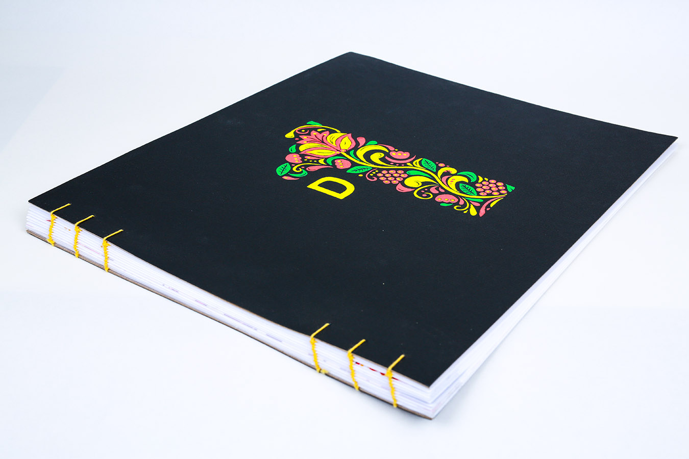"Design 1 Process Book - Bruce Claypool's class, Design 1, required a process book on color theory and basics of composition. The book style must represent the student personality. As a Russian my choice was to hand paint number 1 Khokhloma style and Helvetica D for ""design"". The binding was done in Coptic Stitch style.PFD of the book"
