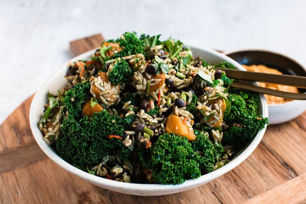 VeganGreen Rice Salad - with braised black beans, coriander, seeds and carrot hummus