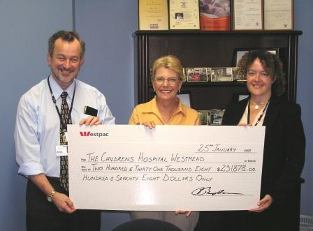 $231,878.00 cheque presentation to The Children's Hospital at Westmead  Left to right: Dr. Michael Stevens, Senior Staff Specialist Oncology Unit, Westmead. Lynne Bodman co-founder Kids with Cancer Foundation Australia. Nicola Mackay, Fundraising Manager (Oncology) Westmead.