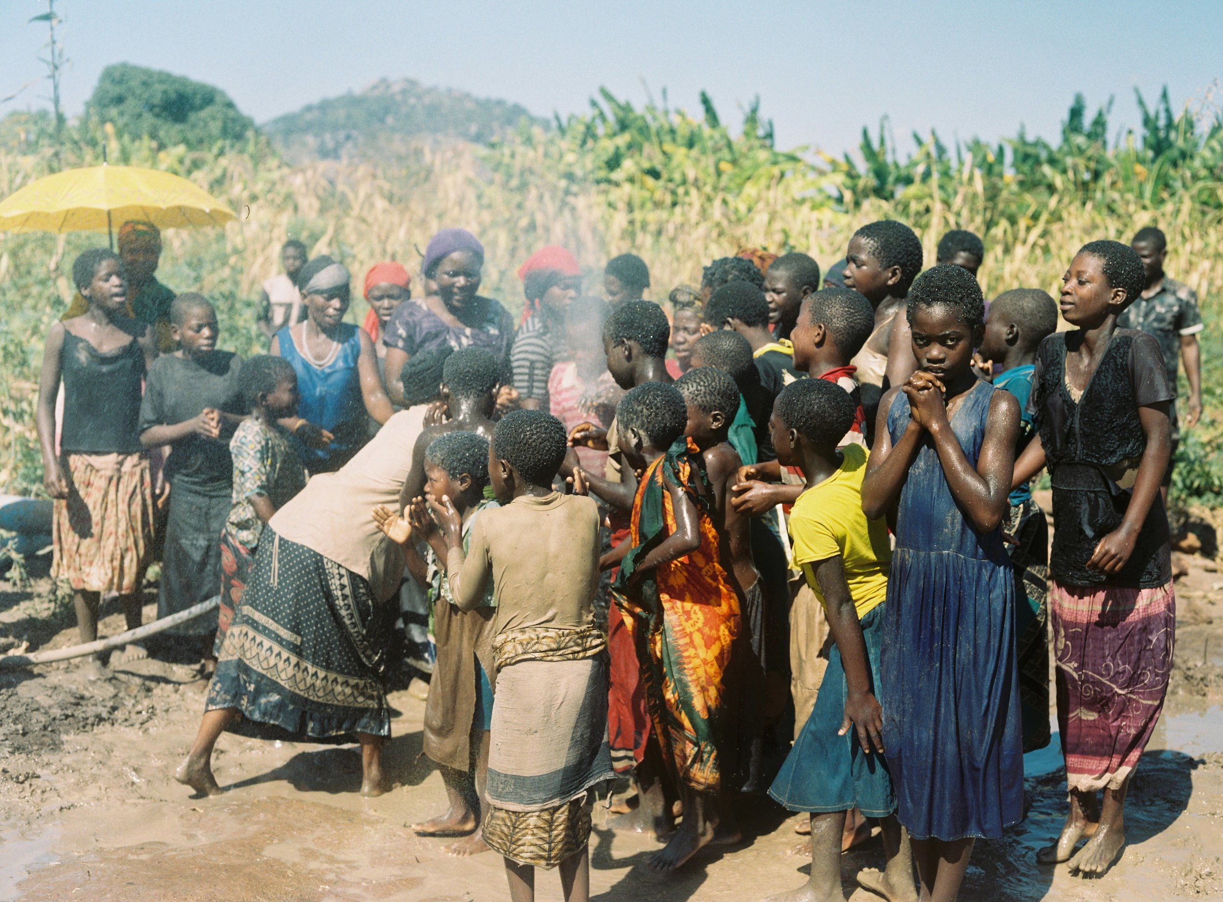 Malawians celebrate the first ever borehole placed in their area.