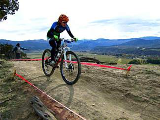 A competitor navigates the Haymaker Trail during the Colorado High School Cycling Legue Championship held this fall in Eagle. The developers of the Haymeadow project agreed to allow an easement accorss the property so the trail could be built, and have indicated an extensive trail network is part of their overall plan for the development
