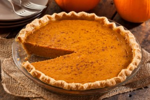 - 1 unbaked 10‑inch prepared or homemade pie shell, chilled1 ¾ cups homemade or canned pumpkin puree¾ cup firmly packed golden brown sugar2/3 cup cream cheese, at room temperature3 eggs1 ½ cups half‑and‑half (half cream)1 teaspoon vanilla extract (essence)½ teaspoon ground ginger½ teaspoon ground allspice, plus extra for garnish¼ teaspoon ground cinnamon1/8 teaspoon ground clovessaltunsweetened whipped cream for serving, optional