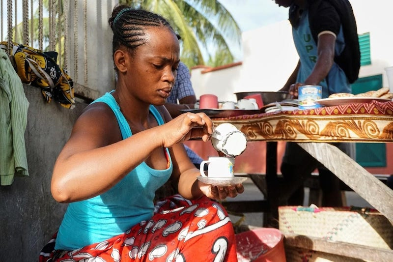 nicole-motteux-sustainable-coffee-advocate-seller-pouring-coffee madagascar.jpg