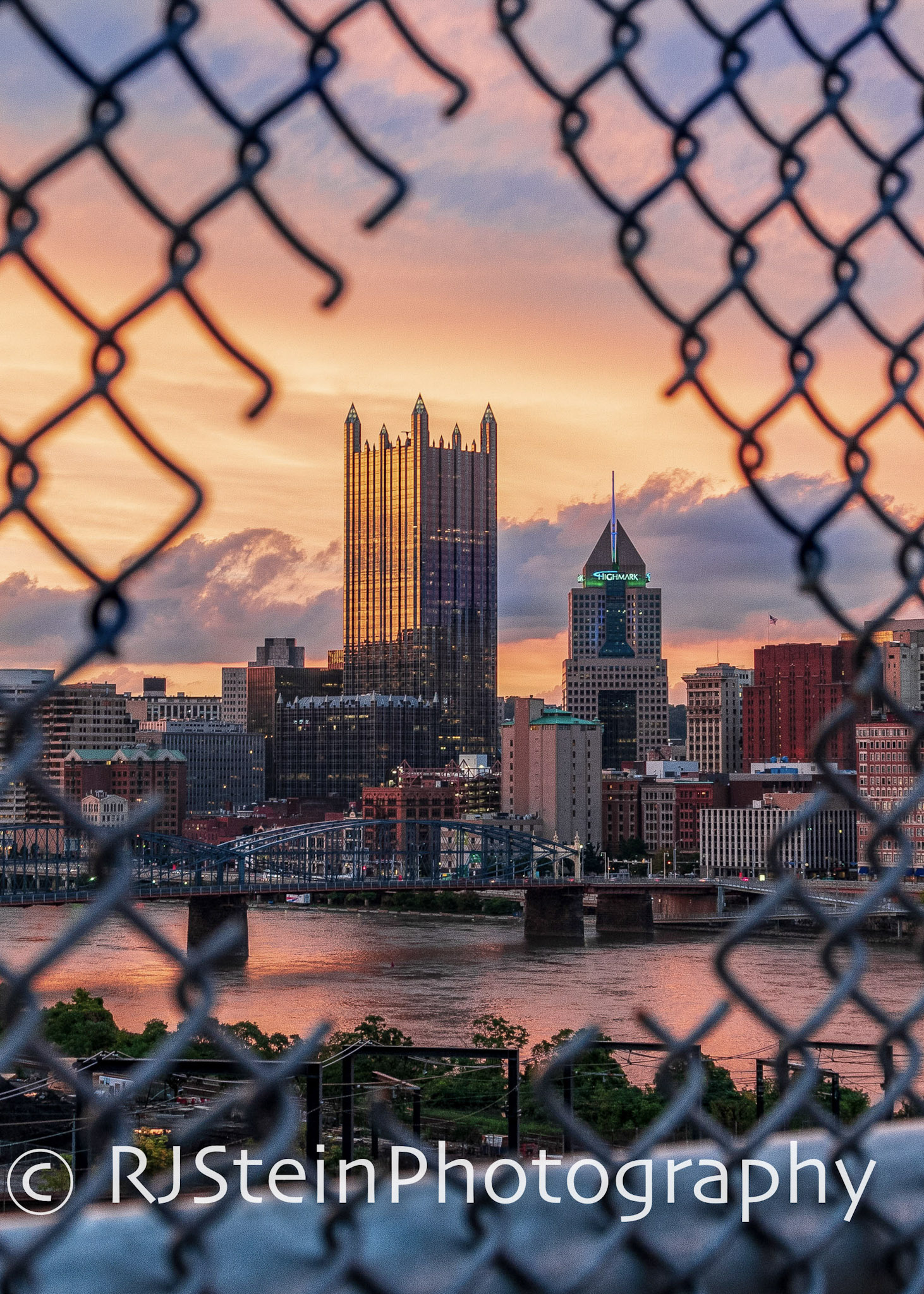 sunset through the fence, pittsburgh, 2018