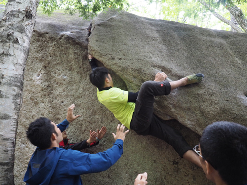 Wet slippery rock and lack of crash pads won't stop Chris from having a go at this V1 problem.