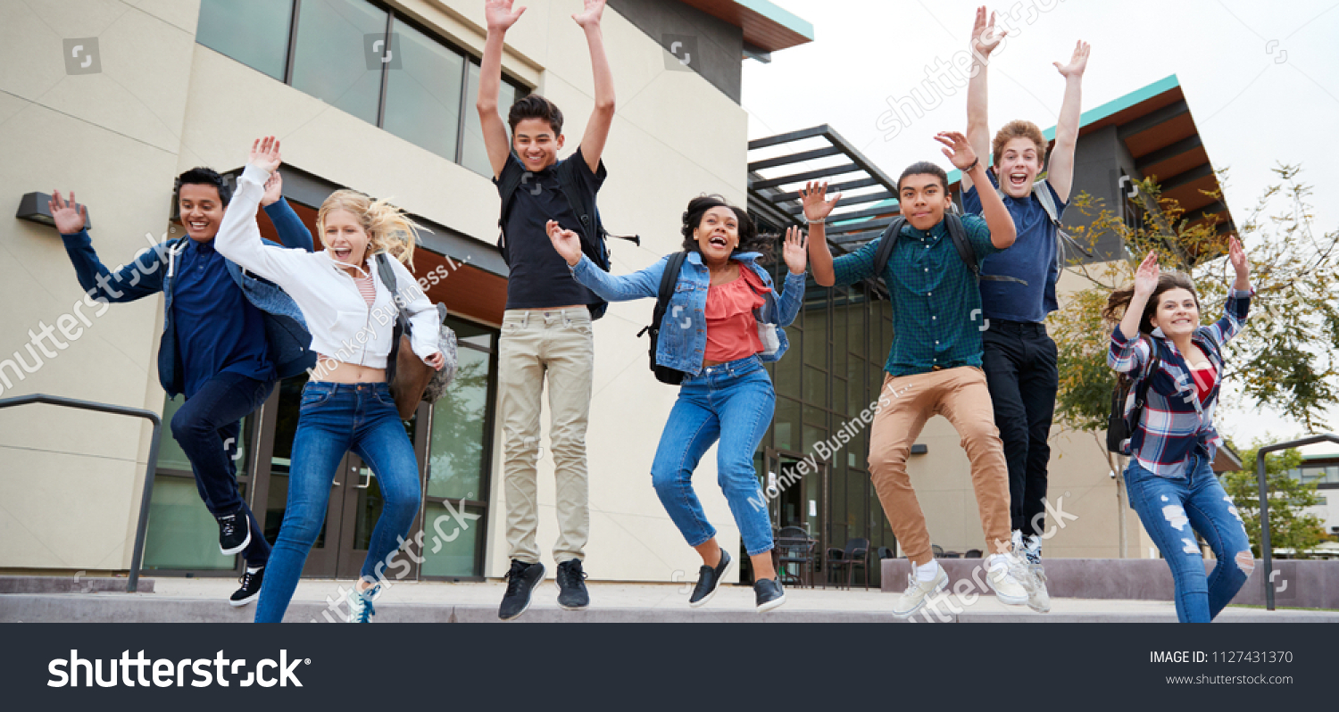 stock-photo-group-of-high-school-students-jumping-in-air-outside-college-buildings-1127431370.jpg
