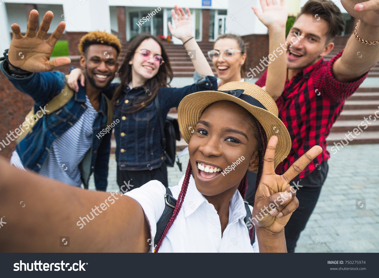 stock-photo-students-with-beaming-smiles-are-posing-for-selfie-shot-750275974.jpg
