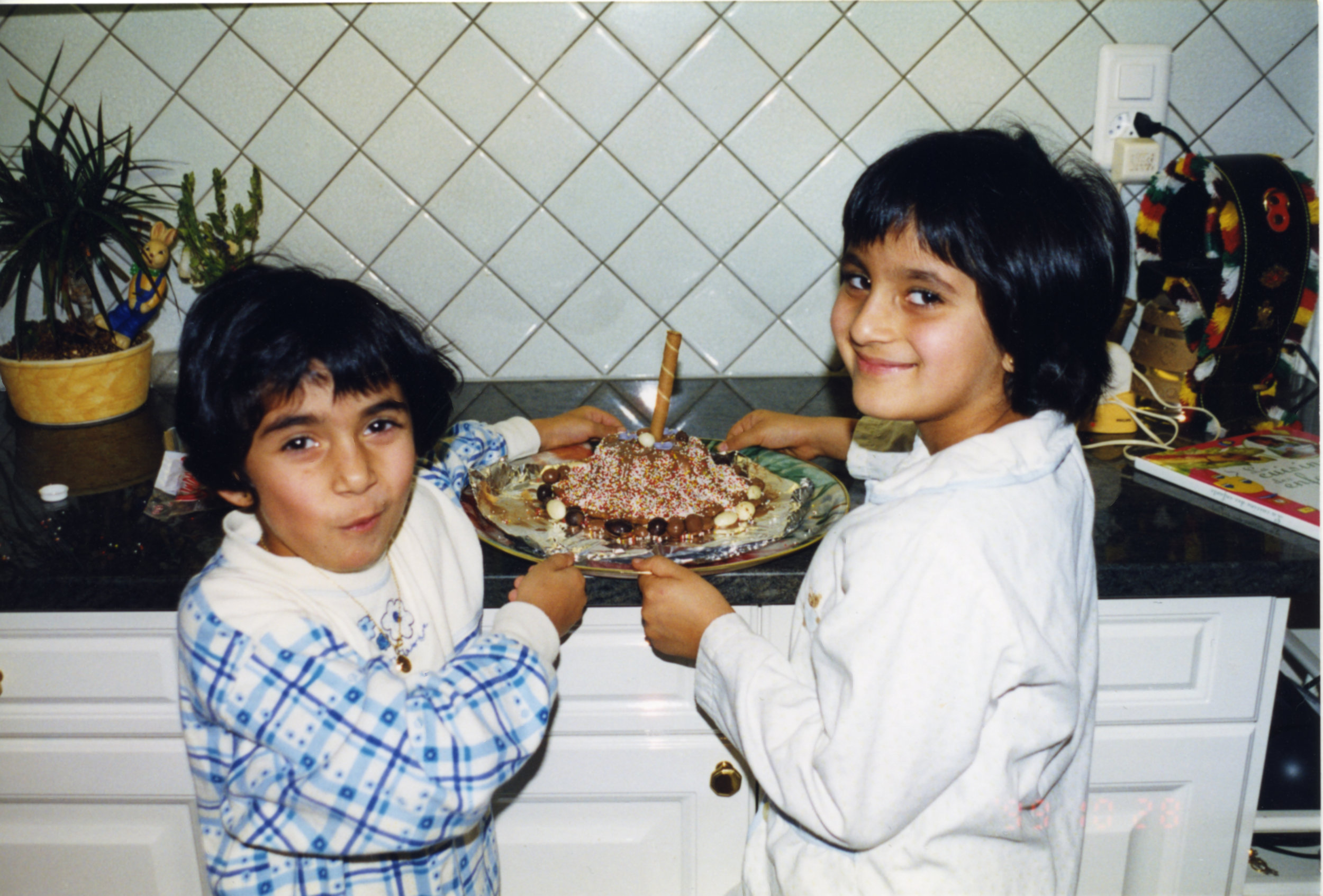 My sister and I baking a cake in 1997