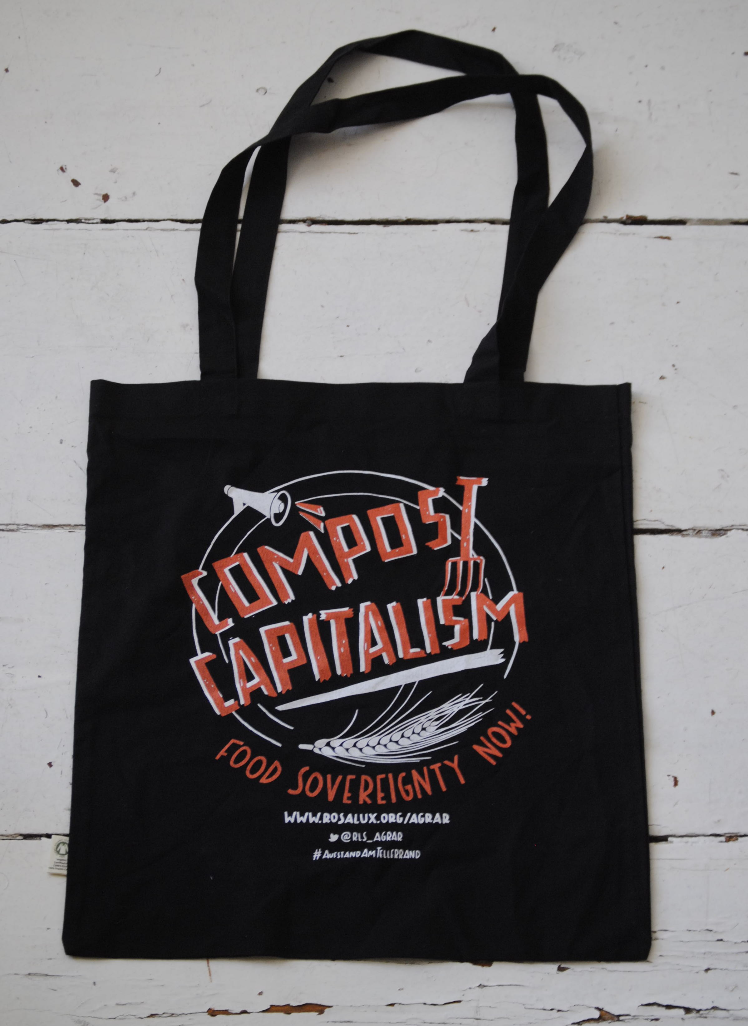 Pictured is a reusable grocery bag given out at the meeting. Compost provides a fertile growing medium for our food. How could 'composting capitalism' use the unprecedented levels of global wealth and prosperity generated in the past centuries as a growing medium for novel evolutionary solutions to the twenty-first century's most pressing global issues?