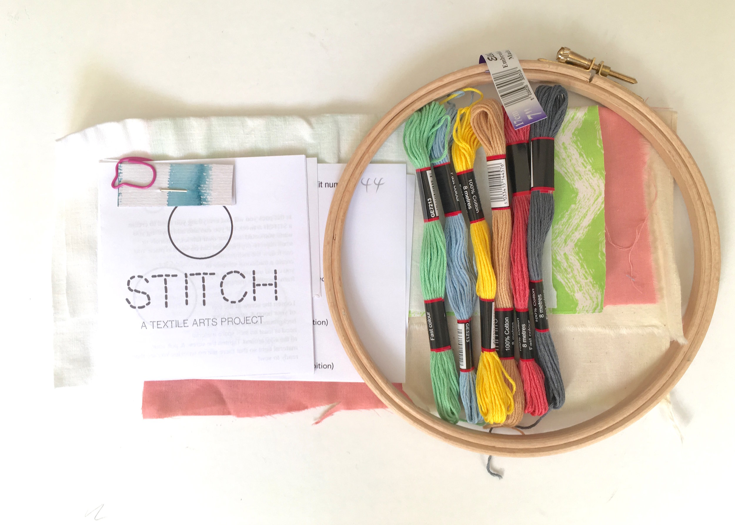 The contents of your STITCH pack should look a bit like this. Obviously the materials will vary, but you should expect to find an embroidery hoop, a selection of embroidery threads, a choice of fabrics, an instruction leaflet, address label, sewing needle (in a folded piece of card) and an information leaflet to fill in. -