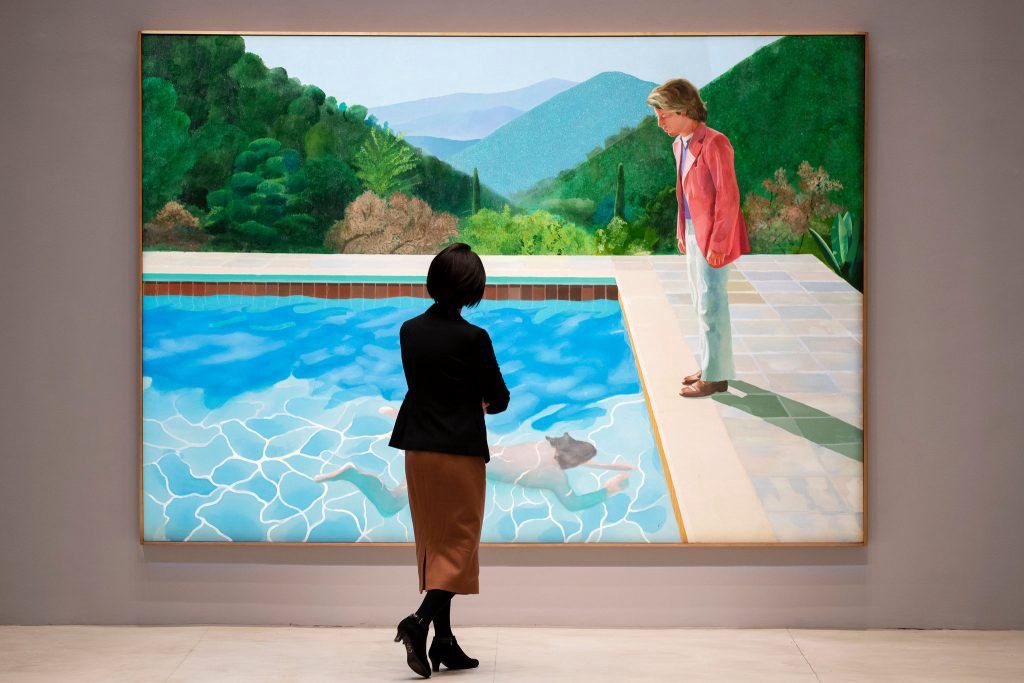 """NEW YORK, NOV. 14 Viewing David Hockney's """"Portrait of an Artist (Pool With Two Figures)"""" at Christie's, where it fetched a record price for a work by a living artist.  Karsten Moran for The New York Times"""