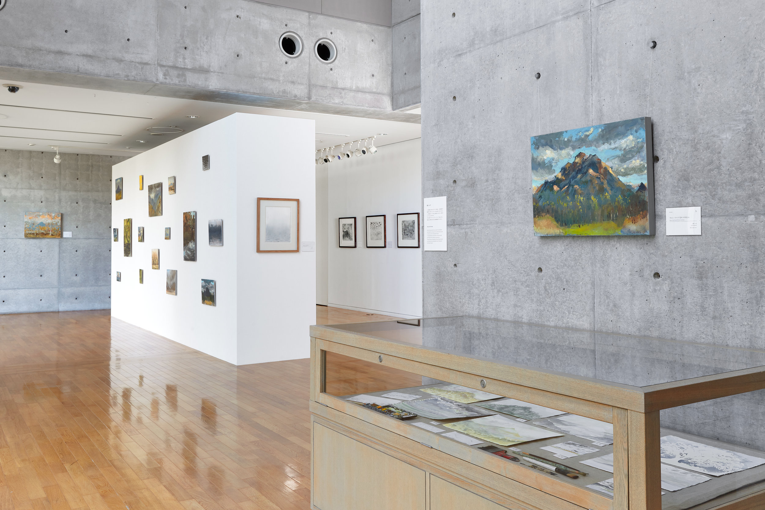 A view into the gallery of works on paper and the 'Wall of Song': an assortment of small works of oil on panel