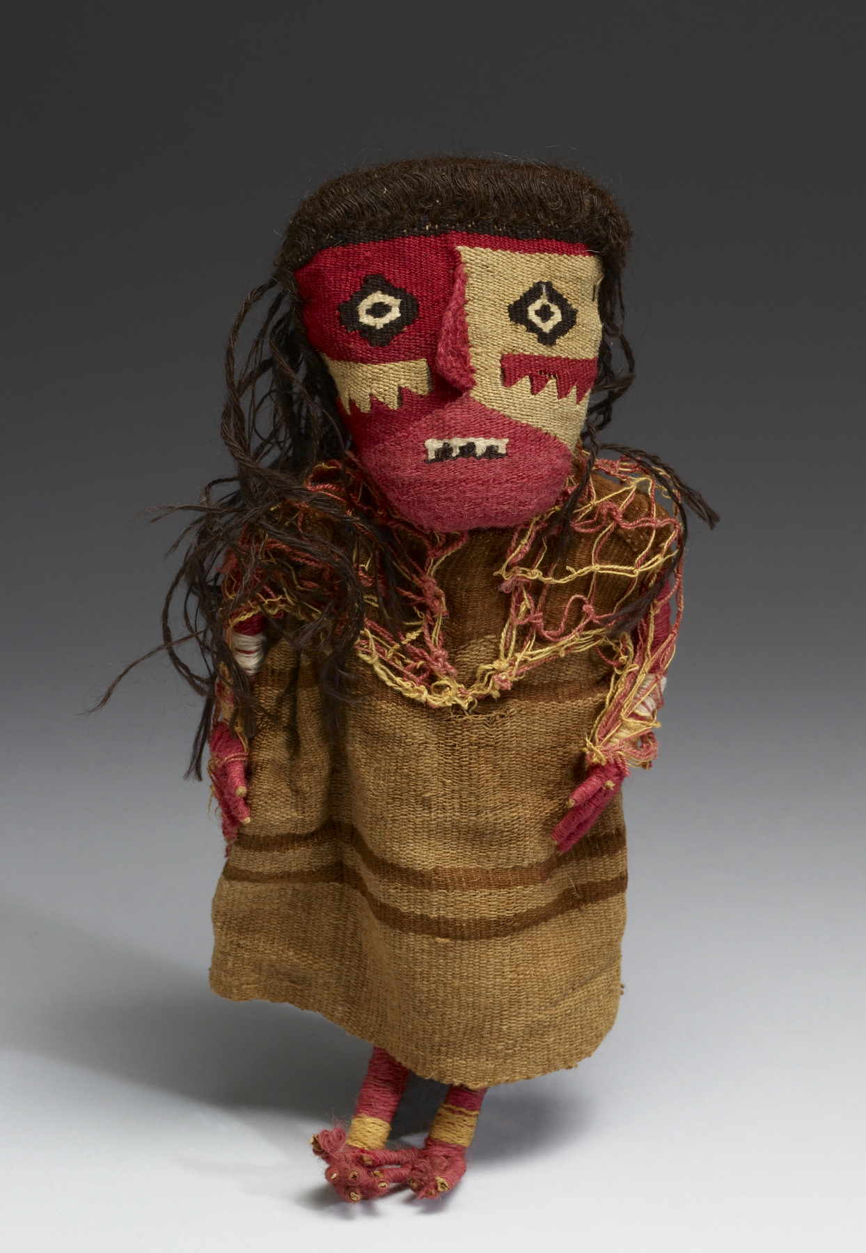 Chancay    Textile Doll , between c. 1000 and 1450 AD,, cotton, wool, wood. 12 ″x5.5 ″x1.4 ″,   Walters Art Museum