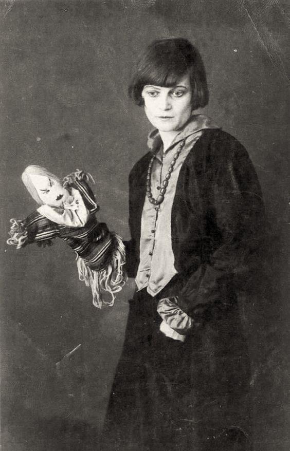 Swiss Dadaist Emmy Hennings with one of her dolls. 1917.