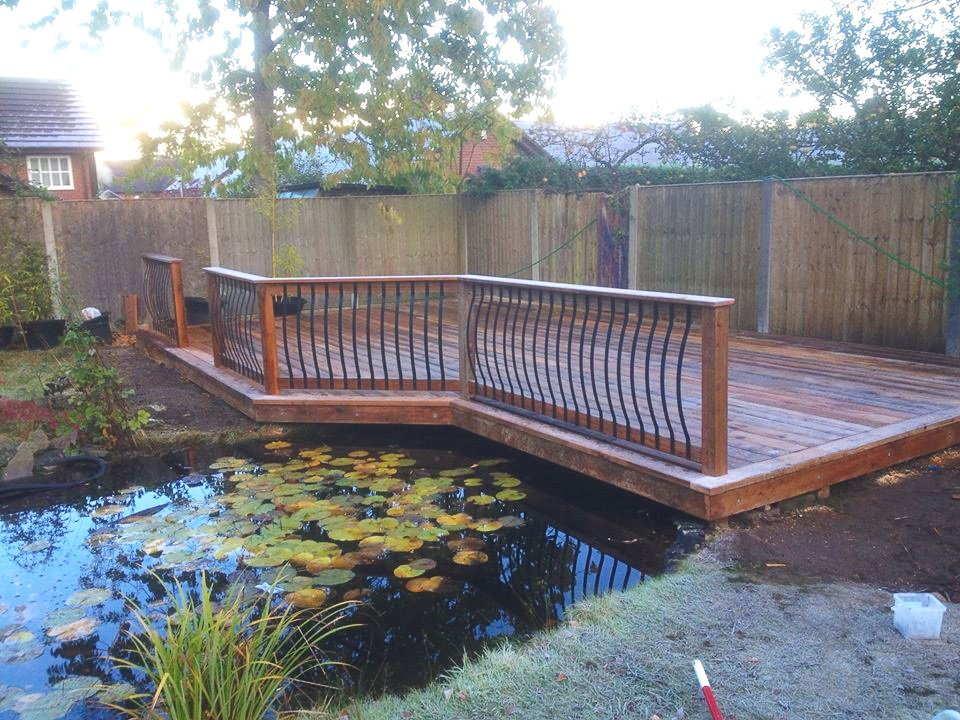 Outside space designed and built this stylish decked area using our pro-wax grooved decking and individual metal spindles.