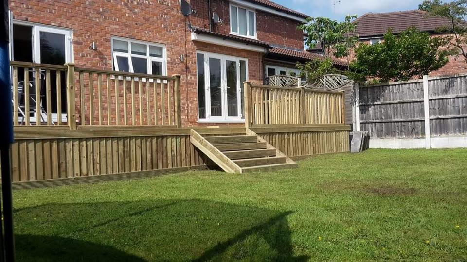 This raised deck area was designed and built by Marshalls Landscaping Services using our pro-wax grooved decking, spindle balustrade panels and feather edge.