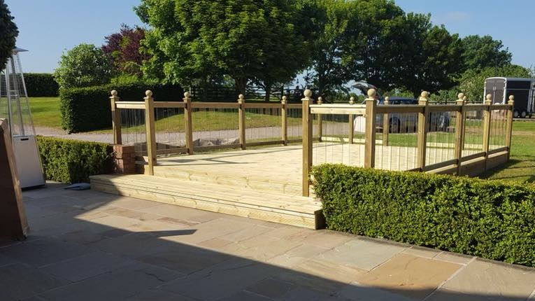 Preswood decking created this beautiful suntrap using our pro-waxed decking and finials.
