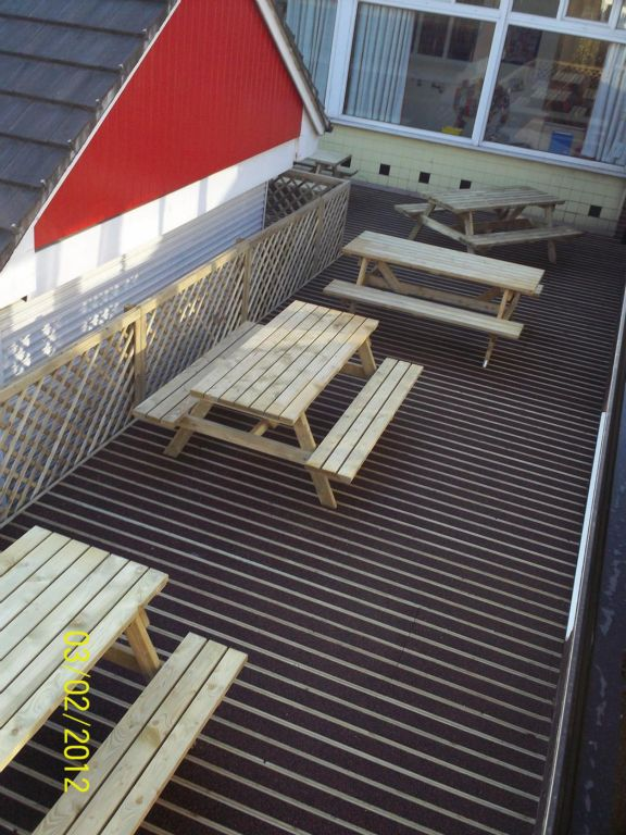 Preswood Decking created this safe antislip area for a local school complete with picnic tables.