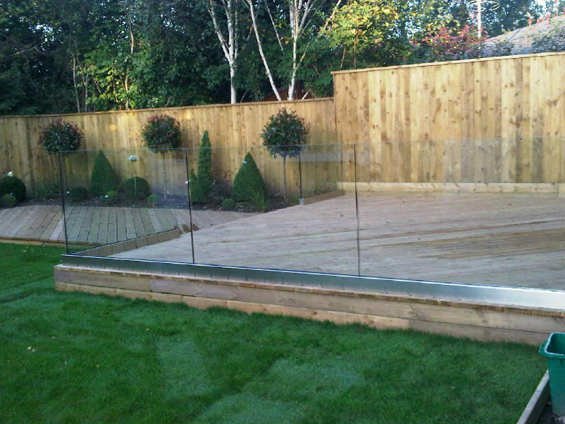 A stunning decked area created by Bespoke Gardens of Cheshire using our redwood deck boards.